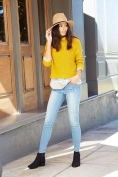 This look is giving us major retro vibes in all the right ways. Embrace your inner flower child in this yellow sweater paired with washed jeans. Add a camel panama hat to modernize the look for a swoon-worthy spring outfit.