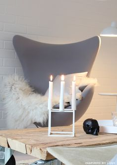 Egg chair by Arne Jacobsen from Fritz Hansen and Kubus 4 candle holder from by Lassen