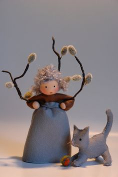 The little doll is made of 100 % wool-felt, fairy tale-wool and tricot material. It comes with the cat :-) The doll is approx. 13,5