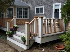 Cape Cod style deck. Love the driftwood grey decking with white and wood accents. Could swap out wood balusters for no-maintenance metal ones, would still keep that classic Cape Cod mix of casual/classic.