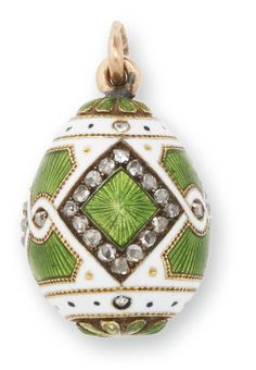 1898-1903. Fabergé gold and guilloché enamel Easter egg pendant. Workmaster Michael Perkhin, St. Petersburg. Enamelled in translucent green over an engine-turned ground within diamond-set borders and an opaque white ground, struck with workmaster's initials, 56 standard.
