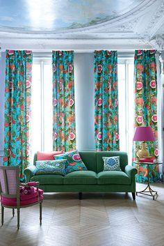 Love the idea of pinch pleat drapes in a retro-tastic fabric hung at the ceiling in the living room. What a statement!