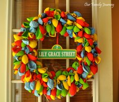 Birthday Balloon Wreath (minus the Seasame Street name plate)- would be a great reusable door wreath for everyone's B-day! Could embellish in soooo many ways!!!