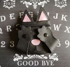 A cute kitty purse, with paws to hide the eyes!