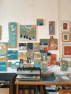 The walls of Etsy seller Kristiana Parn's studio are filled with collections of her cheery paintings.