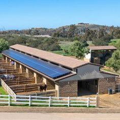 Each horse gets their own outdoor area connected to the stalls. Love the solar panels