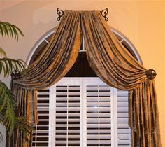 shutters with drape for arched windows - definitely a diff fabric for curtains