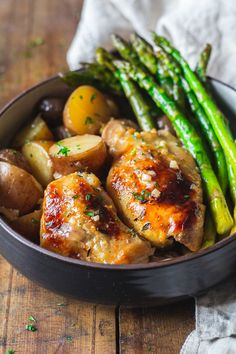 A super easy Slow-Cooker Lemon Chicken recipe full of lemon flavor and tons of delicious garlic. No need for sides as the potatoes and veggies are cooked right in the crockpot with the bone-in chicken thighs.