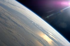 Earth with its thin blue atmosphere and ISS with its thin silver hull – both protecting their humans from the harsh vacuum of space; both reminding us that wherever humanity chooses to 'reside', we are obligated to take care of that place – our home.
