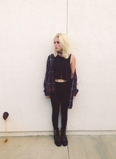 Black crop top , black leggings , black boots , flannel