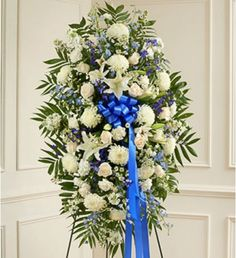 Beautiful blue and white flowers offer a comforting symbol of your heartfelt compassion and support.