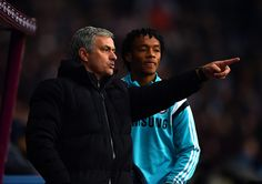 Jose Mourinho, manager of Chelsea speaks with new signing Juan Cuadrado of Chelsea as he prepares to come on as a substitute during the Barclays Premier League match between Aston Villa and Chelsea at Villa Park on February 7, 2015 in Birmingham, England.
