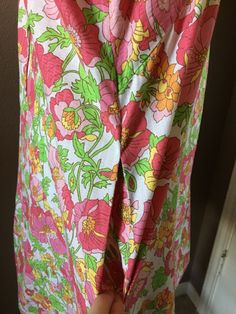 "Up for sale - one darling floral print dress! Back zipper. Short sleeves. Empire waist. 2 lines of pleating in the back. One side pocket. - Bust: 40"". 