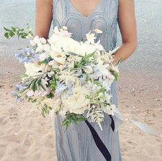 This image is really giving us those ocean blue vibes we love! Stunning dress details and bouquet via @heygorgevents.  Dress by @adriannapapell. Film by @coryweber as seen on @weddingsparrow.  #bridesmaid #weddinginspo #weddingfashion #flowersoftheday #flowersofinstagram #bouquet #blue #somethingblue #bride #bridetobe #engaged #shesaidyes #isaidyes #love