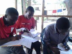 The young people of Gidan Almajirai at their books.