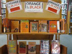 Orange is the New Black - should I put up orange books or prison books?