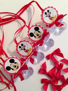 """Mickey Mouse Baby Shower Pacifier Necklace. This beautiful Mickey Mouse pacifier necklace are a fancy way to present favors for your Baby Shower. Use these cute baby shower pacifiers as baby shower favors and a """"Don't Say Baby"""" game. The necklace is made of 1/8 satin ribbon. Each pacifier measures 2 1/2"""" long. Have two-sided mickey mouse and bows."""