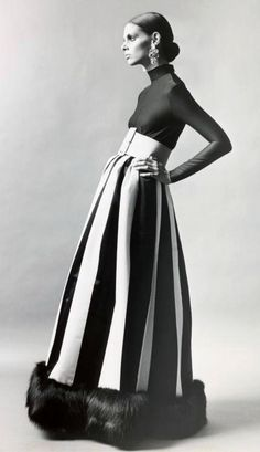 A lady wearing an evening gown by Norman Norell, 1972.