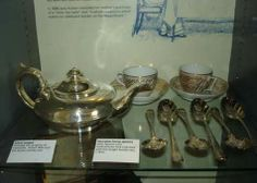 """""""This silver teapot is dated 1832 and bears the Austen family crest; it probably belonged to Cassandra. On the right are silver Georgian berry spoons from Godmersham Park (the estate inherited by Jane's brother Edward), engraved with the Knight family crest, c. 1812."""" -Syrie James http://austenauthors.net/jane-austens-house-museum-my-visit-in-pictures"""