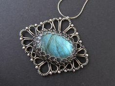 wire wrapped green labradorite necklace silver. $123.00, via Etsy shop: AnnieJewelry