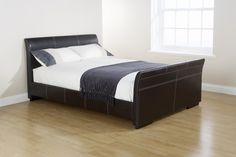 The York bed, with its low and modern sleigh design, sturdy wooden feet and excellent sprung slatted base will stand as a striking and elegant centrepiece to your bedroom. £195