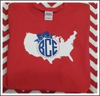 Red tee with white USA and blue circle monogram with bow.