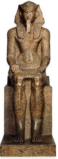 Red granite statue of King Sekhemrawadjkhau Sebekemsaf, from Karnak; Seventeenth Dynasty, Egyptian.