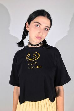 NIRVANA TEE || SHOP HERE: https://www.goodbyebread.com/collections/internet-girl/products/dumb-nervana-tee #goodbyebread #internetgirl #photoshoot #vintage #grunge #oversized #cropped #tee #print #dumb #nirvana #smiley #choker #yellow #mini #pleated #skirt #smells #like #teen #spirit