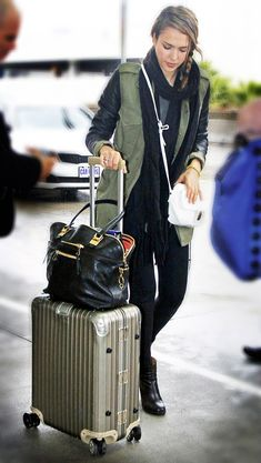 Jessica Alba travel style inspiration. Dark colors. Layers.