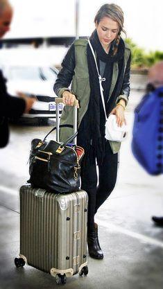Jessica Alba travel style inspiration. Dark colors. Layers.