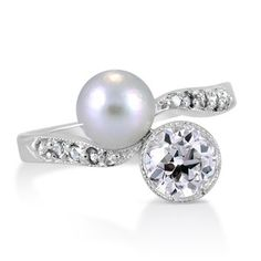 The Hawaii Ring, 1910's diamond & pearl It would be so sweet if he got this for me! Not for a wedding ring but just to get me a pretty ring  I love pearls and diamonds!