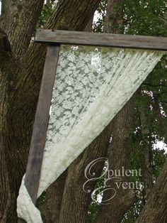 Weathered timber draped with lace wedding arch - vintage / farmhouse wedding accent cake table