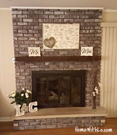 How I updated our fireplace by painting the outdated brass cover ...