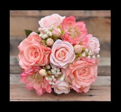Peach, melon and coral tones... See more here: https://www.etsy.com/listing/266982924/peach-rose-wedding-bouquet-silk-flower?ref=shop_home_active_6