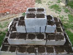 Cinder Block Strawberry pyramid...could use up a lot of my blocks! Could put in on the back side of the garden. 2 tiers with a 3rd as a small top
