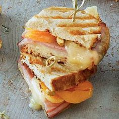 Fancy Ham and Cheese - Oh-So-Good Panini Recipes - Southern Living - We raise the bar with our Fancy Ham and Cheese sandwiches adding Gruyere cheese, dried apricot halves, and toasted pistachios. Recipe: Fancy Ham and Cheese Pannini Sandwiches, Wrap Sandwiches, Paninis, Panini Recipes, Cheese Recipes, Yummy Recipes, Apple Sandwich, Grilled Sandwich, Grilled Ham And Cheese