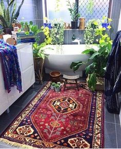 Lovely rug and gorgeous bathroom. Just beautiful www.naturalarearugs.com