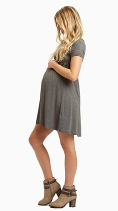 Look no further for a cute nursing dress you can look and feel great in. This classic draped front style makes nursing easy with a v-neckline and a cinched under bust style gives you a flattering silhouette while showing off you bump. Style this dress with maternity leggings and flats or boots for a perfect casual outfit.