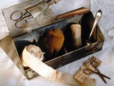 Bandages, a sponge, scissors, a spoon for caring for patients. Germ theory had not been introduced, so these instruments were not cleaned between patients.