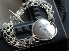 Artisan Fine Silver Cross Medallion Bracelet | 2 Sisters Handcrafted Original Design Click the picture or visit www.2sistershandcrafted for more details #finesilverjewelry, #crossbracelet #2sistershandcrafted #faithjewelry