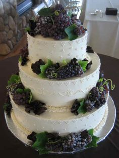 The Vineyard Wedding Cake is decorated with Champagne Grapes,  Dark Belgium Chocolate Curls, Sugar Pearls & fresh Grape leaves from a local vine.  By Jillicious Desserts Bakeshop  jill@jilliciousdesserts.com  Philomath, Oregon