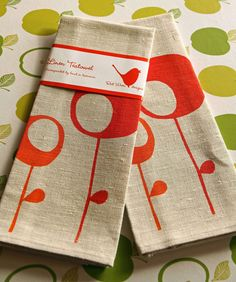 love to look for great graphics and color on tea towels and these are super!  Etsy RedWrenDesigns.
