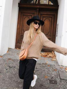 Janessa Leone hat, Céline sunglasses, Acne Studios knit, Mansur Gavriel bag, Bassike track pants. Via Mija