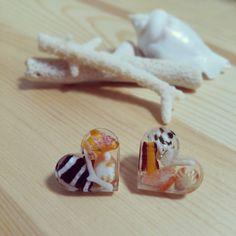 ~南の島の貝殻ピアス(ハート)~様々な色の貝殻とサンゴを使用した世界に一つの宝物ピアス☆コーディネートのポイントになります☆※写真4枚目はご使用イメージになり...|ハンドメイド、手作り、手仕事品の通販・販売・購入ならCreema。
