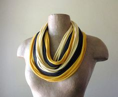 T-Shirt Scarf: Take an old t-shirt, snip it up, and turn it into a fashionable scarf. There are so many different styles to choose from — fringing, braiding, and more. Here is a list of instructions on how to make 10 different types of t-shirt scarves. Source: Etsy user EcoShag