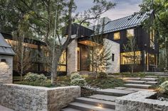 A Colorado Home Puts a Modern Twist on Farmhouse Living - Photo 3 of 11 - The home is composed of limestone masonry and structural steel accents.