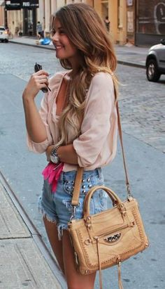 Distressed jean shorts + flowy blouse top. Edgy yet put together.
