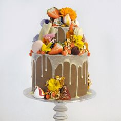Spring Mad Hatter cake with white chocolate drips and fresh fruit
