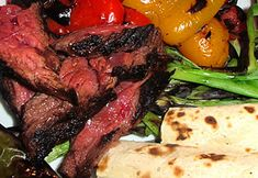 An easy entertaining recipe that always pleases a crowd. Fire up the grill or cook the steak and peppers in a cast iron skillet on top of the stove for the best sear.    This Recipe Courtesy of Jamie Gwen, 2012 www.chefjamie.com