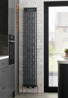 Make a style statement with a sleek, chic and contemporary black vertical radiator. Complement your modern interior; perfect for kitchens.